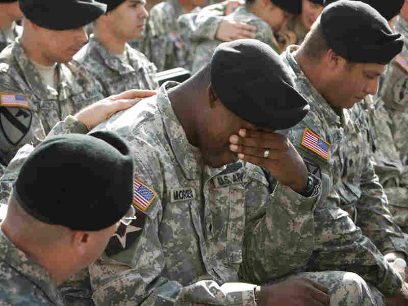 A soldier cries at a memorial service at Fort Hood, Texas, for the victims of the shootings there.