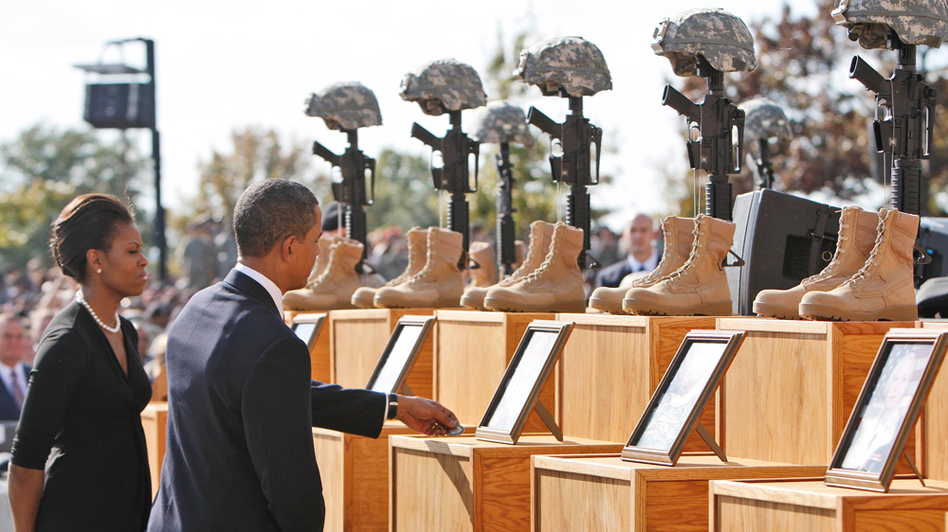 President Obama, accompanied by first lady Michelle Obama, pays his respects to Capt. Russell G. Seager during a memorial service for shooting victims at Fort Hood, Texas.