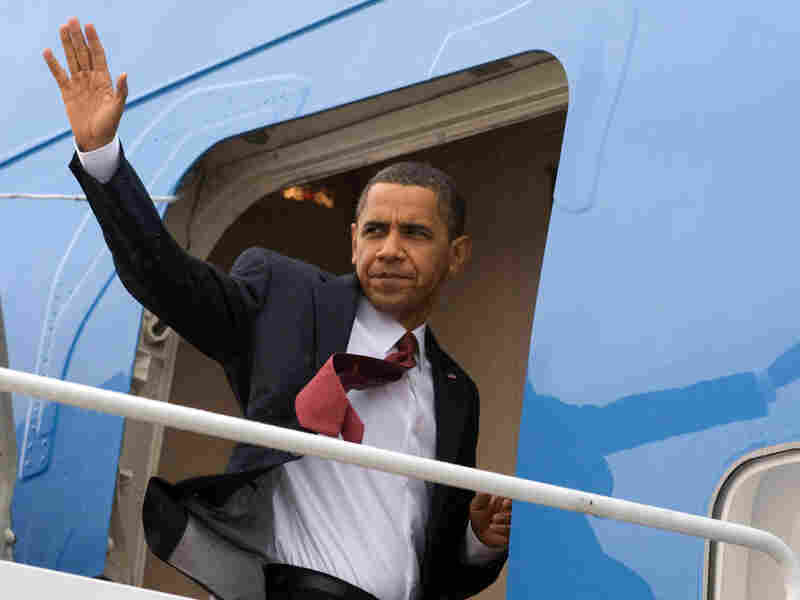 President Obama waves from Air Force One.