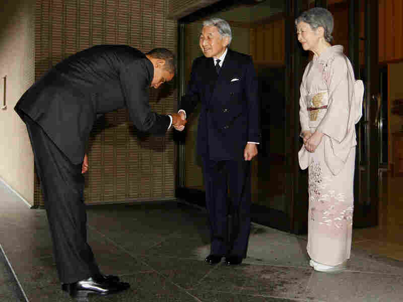Obama bows as he greets Japanese Emperor Akihito and Empress  Michiko. Charles Dharapak/AP
