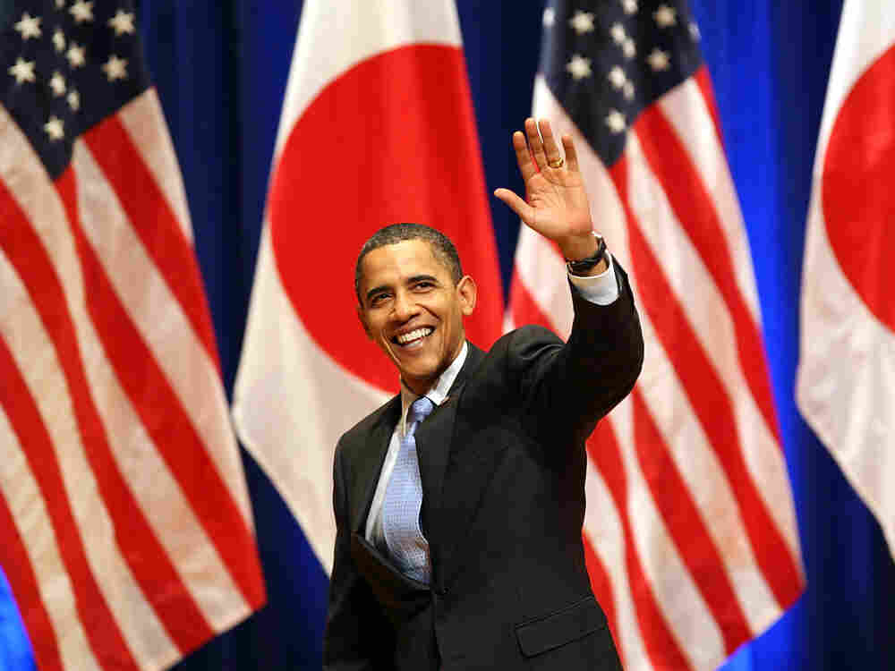President Obama waves after delivering his speech  Saturday in Tokyo. Koichi Kamoshida/AP