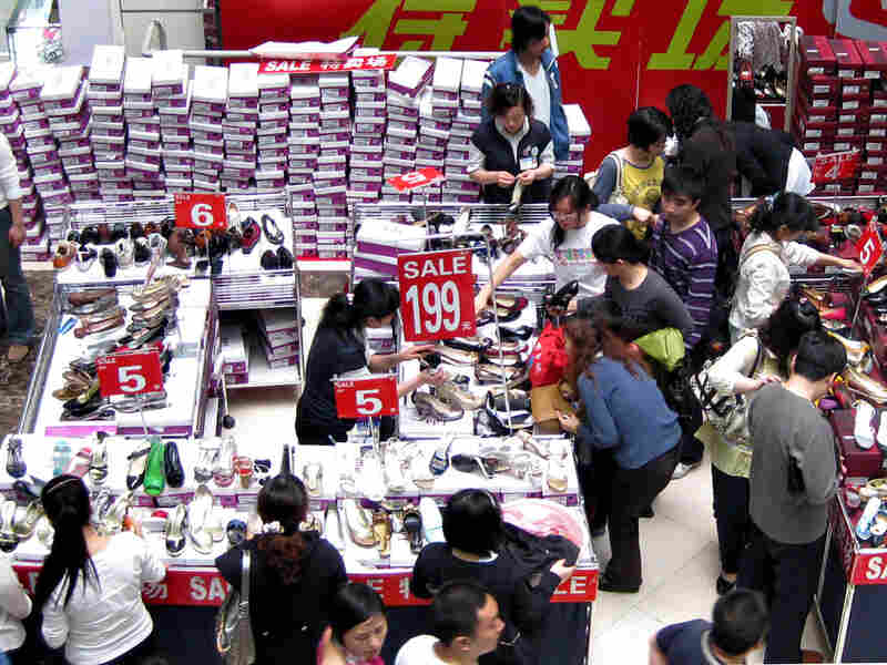 Chinese shoppers buy shoes on sale during a promotion at a shopping mall in Beijing, April 2009.