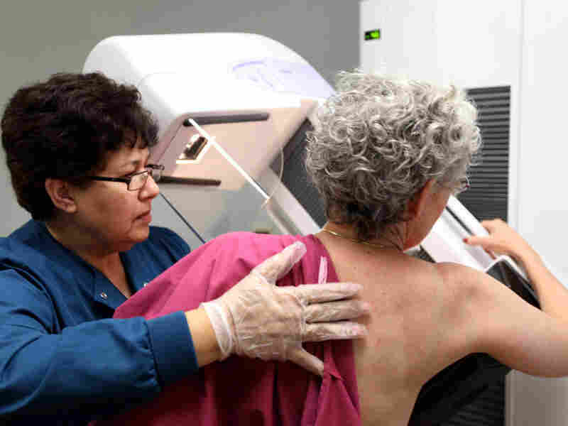 A 65-year-old patient gets a mammogram at Evanston Hospital in Evanston, Ill.,