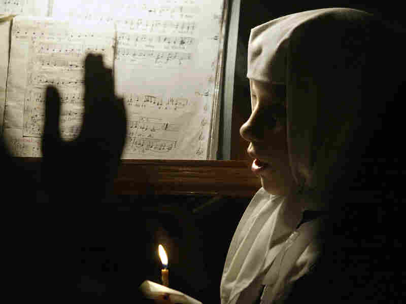 A young conventual sings during an Orthodox Easter celebration Mass.