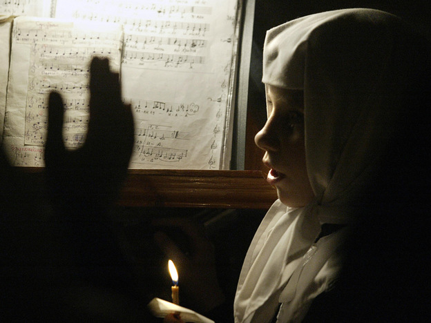 A young conventual sings during an Orthodox Easter celebration Mass at the St. Nicholas convent in the town of Maloyaroslavets, about 80 miles southwest of Moscow, in April 2004.