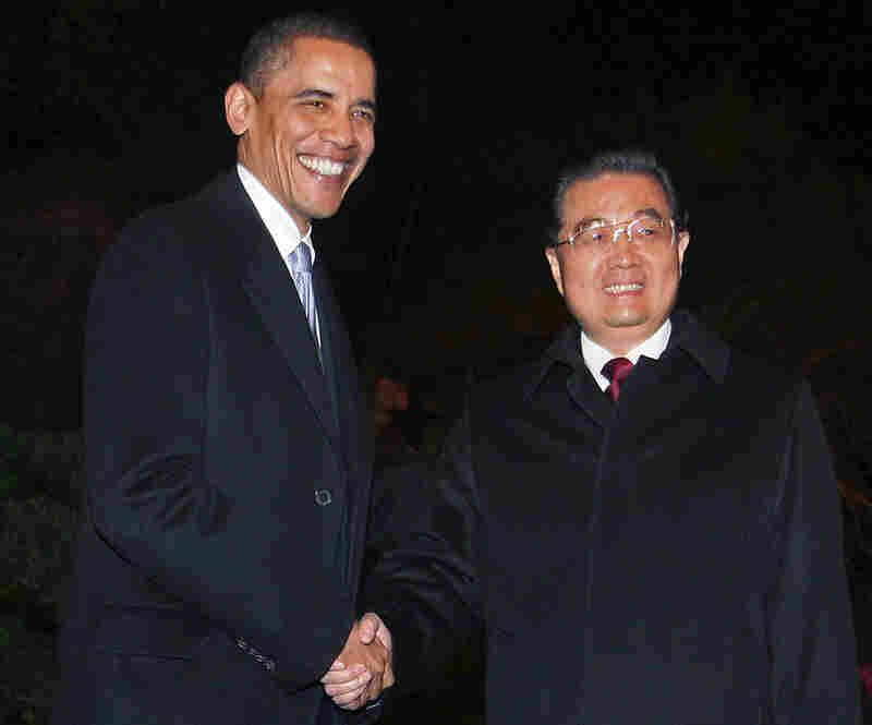 Pres. Obama is greeted  by Chinese President Hu Jintao