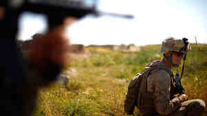W: Lt. James Wende, pictured on patrol in Helmand province