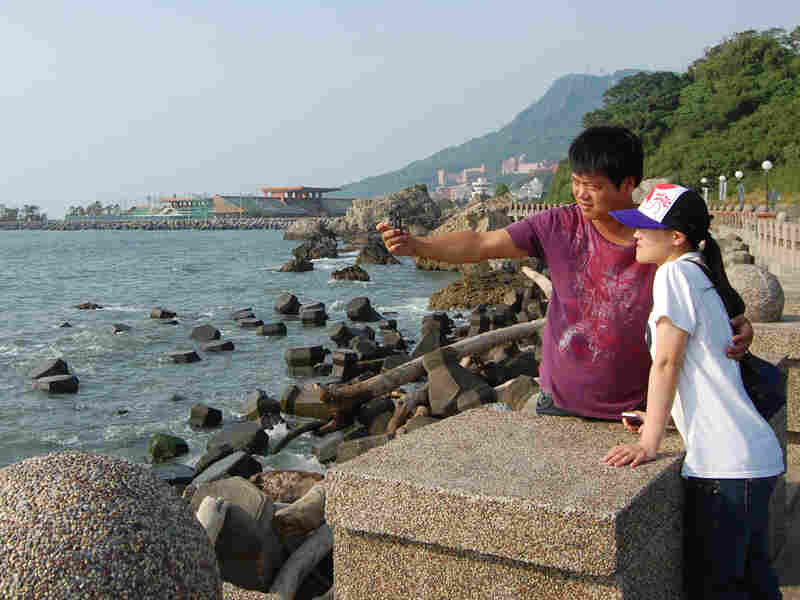 Taiwanese tourists pose for a photo in Kaohsiung, a Taiwanese port city