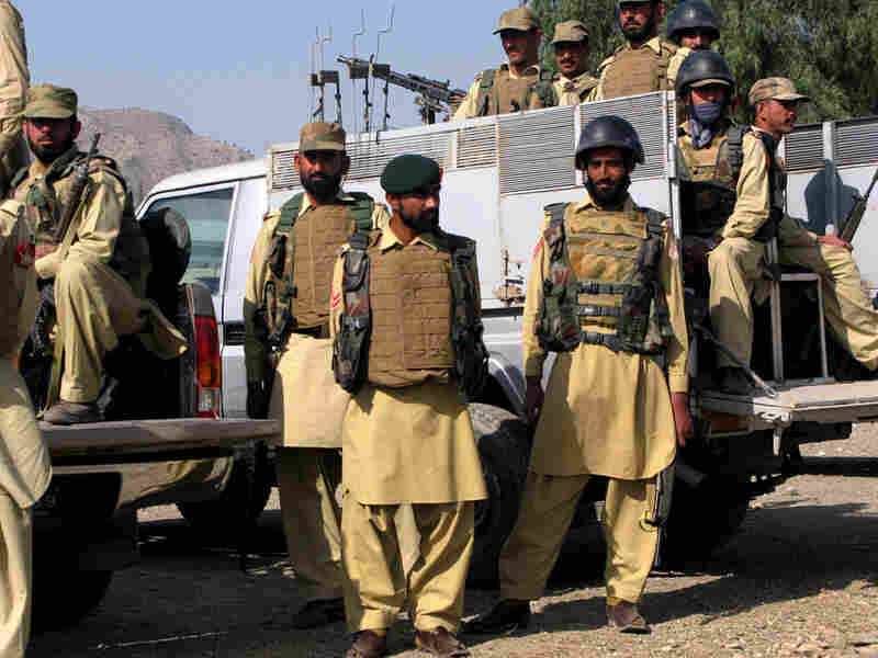 Pakistani military personnel patrol the newly captured