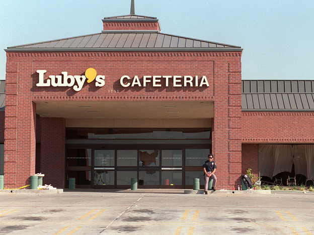 <strong>Oct. 17 1991:</strong> A policeman stands in front of the Luby's Cafeteria in Killeen, where the day before, 23 people were massacred by a gunman who opened fire in the crowded cafeteria before killing himself.