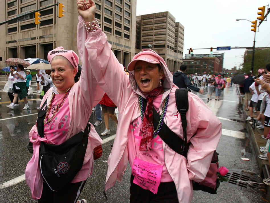 Two women are decked out in pink for a Race for the Cure walk.