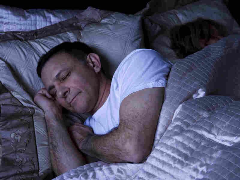 A man sleeps.