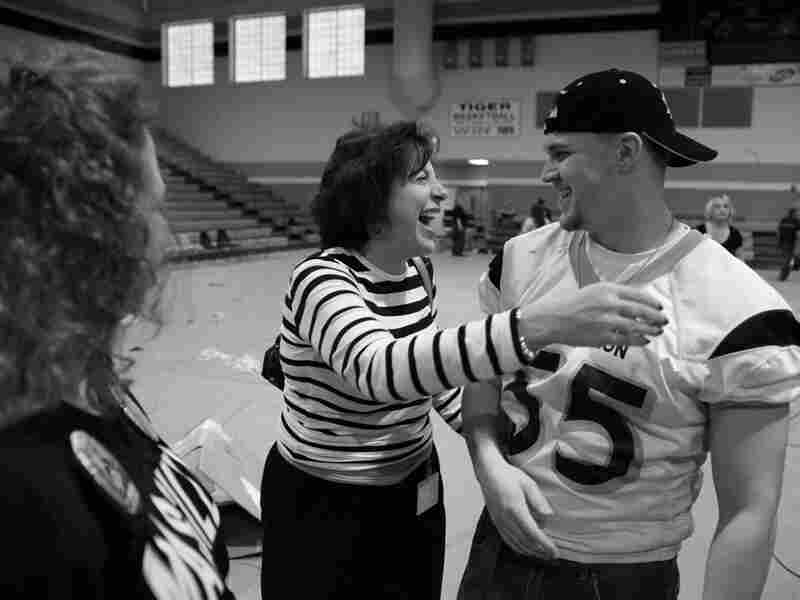 Star player Joe Studer gets a hug at the pep rally.