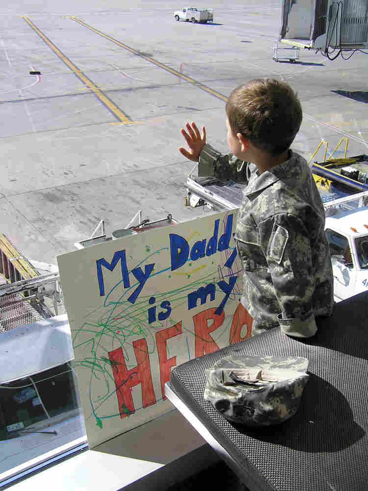 Zack Halander watches his father leave for his second deployment.