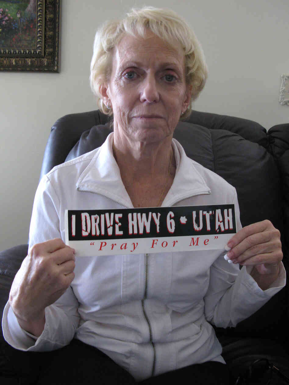 Kathy Justice with a bumper sticker that says I Drive Hwy 6 - Utah Pray For Me