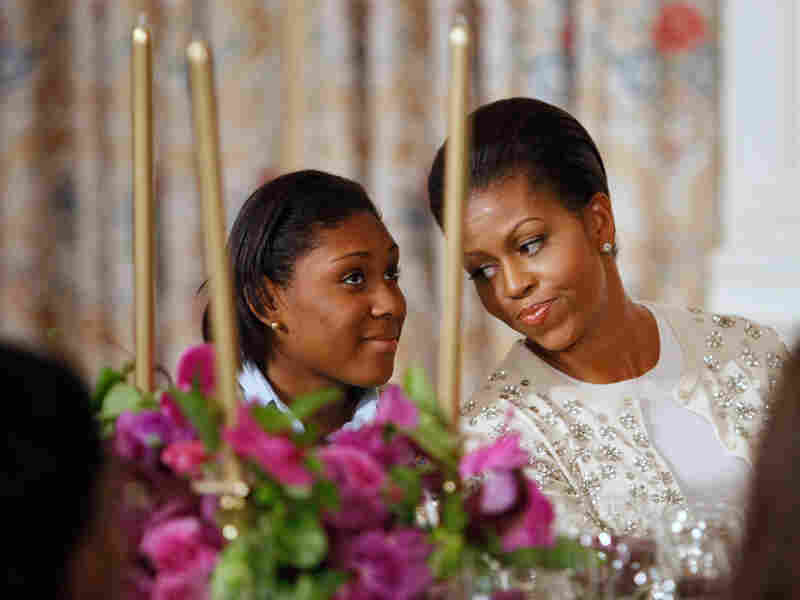 Michelle Obama explains the protocol surrounding state dinners to a high school student.