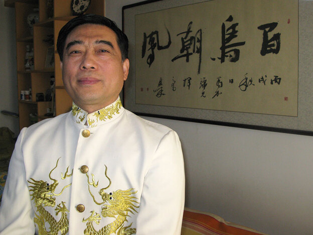 Professional mimic Cheng Jiaqiang, shown here in his Beijing apartment, learned his skills from his grandfather. The calligraphy on the wall behind Cheng refers to his signature act: Cheng imitates a bird imitating a musician imitating a bird.
