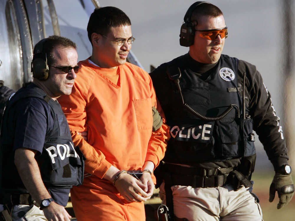 Police escort Jose Padilla