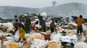 W: Children as young as 7 are among the scavengers at the dump on the outskirts of San Pedro Sula.