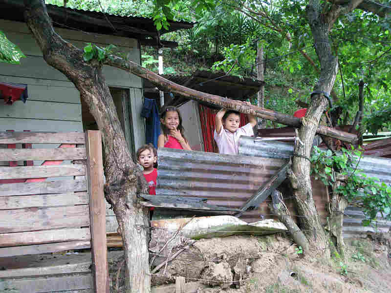 Children pose outside a shack in Ocotillo.