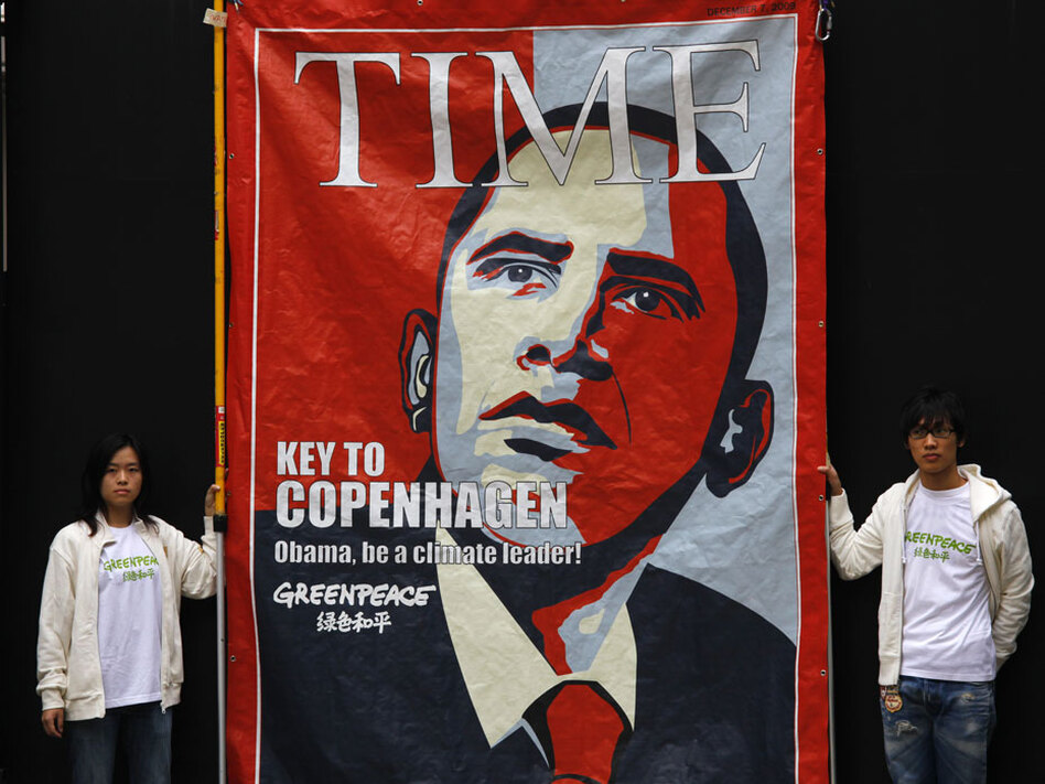 Activists in Hong Kong hang a mock <em>Time</em> magazine cover urging President Obama to help reach an agreement at next month's Copenhagen climate conference.