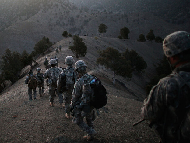 U.S. soldiers march along a mountain ridge in a Taliban stronghold area in Afghanistan's Paktika province, near the border with Pakistan, on Oct. 15. Pakistan is eagerly awaiting President Obama's decision on Afghanistan strategy.