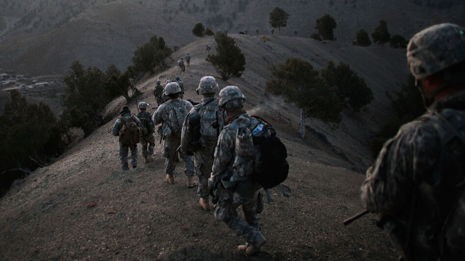 U.S. soldiers file off the ridge of a mountain where they spent the night in a Taliban stronghold area in Afghanistan's Paktika province, near the border with Pakistan, on Oct. 15. Pakistan is eagerly awaiting President Obama's decision on Afghanistan strategy.