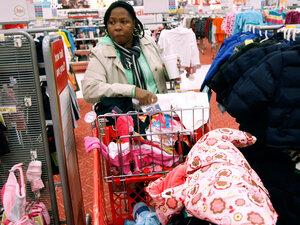 A Philadelphia woman fills her cart with merchandise.