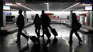 Thanksgiving travelers pass though baggage claim at Chicago's O'Hare International Airport.