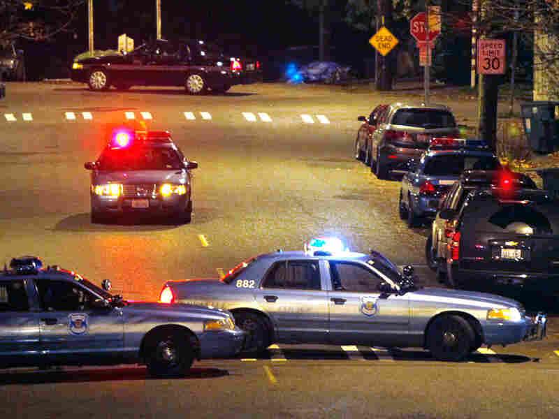 Police cars block access to the Leschi neighborhood