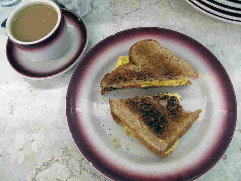 A diagonally cut sandwich.
