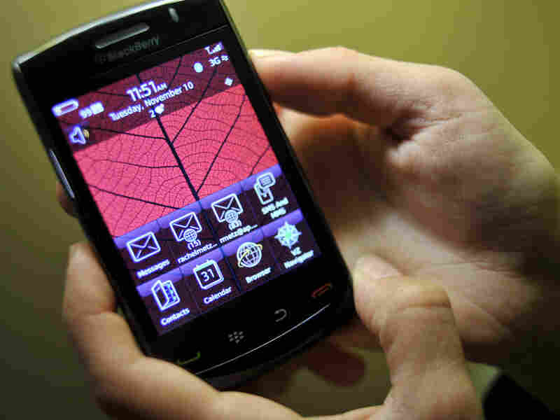 A person handles the new BlackBerry Storm2