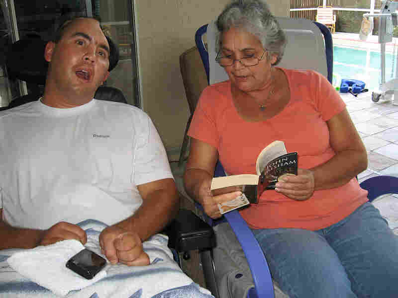 Nellie Bagley reads to her son, Jose, who was wounded in Iraq.