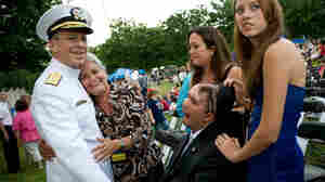 Navy Adm. Mike Mullen, chairman of the Joint Chiefs of Staff, is embraced by Nellie Bagley.