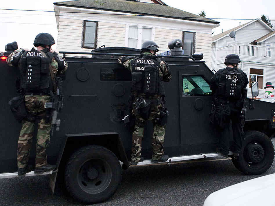 A Seattle police SWAT vehicle leaves the scene of a search for Maurice Clemmons.