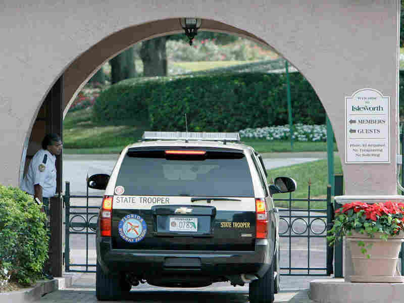 Police car enters the front gate to the community where Tiger Woods lives.