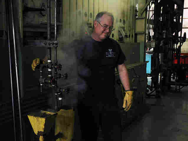 Mark Tucker releases steam from a coal-burning furnace in the Ball State University coal plant.