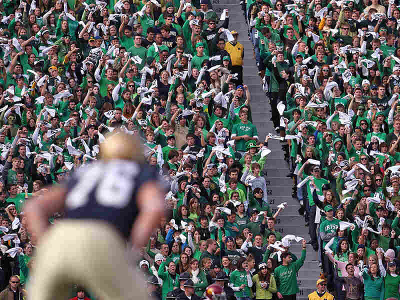 Fans at Notre Dame wave towels before kickoff against USC
