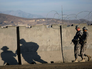 U.S. Army soldiers walk toward a motor pool Wednesday at Forward Operating Base Airborne.