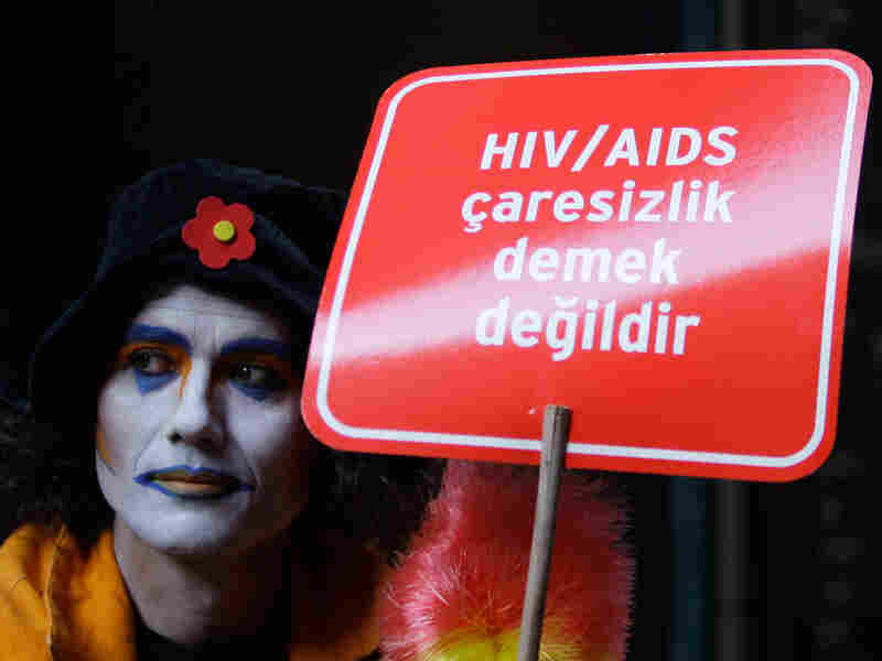 A person holds a placard on World AIDS Day in Turkey