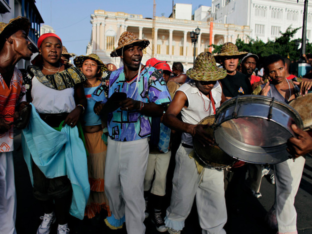 Dancers perform during the annual Caribbean festival in Santiago de Cuba, Cuba, in July. Observers in Cuba say American tourists to the long-forbidden island would like to be drawn to cultural events such as this one.
