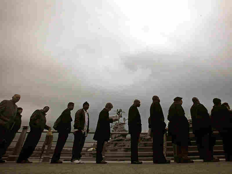 Veterans and family members line up Nov. 23 to attend a career fair in New York.
