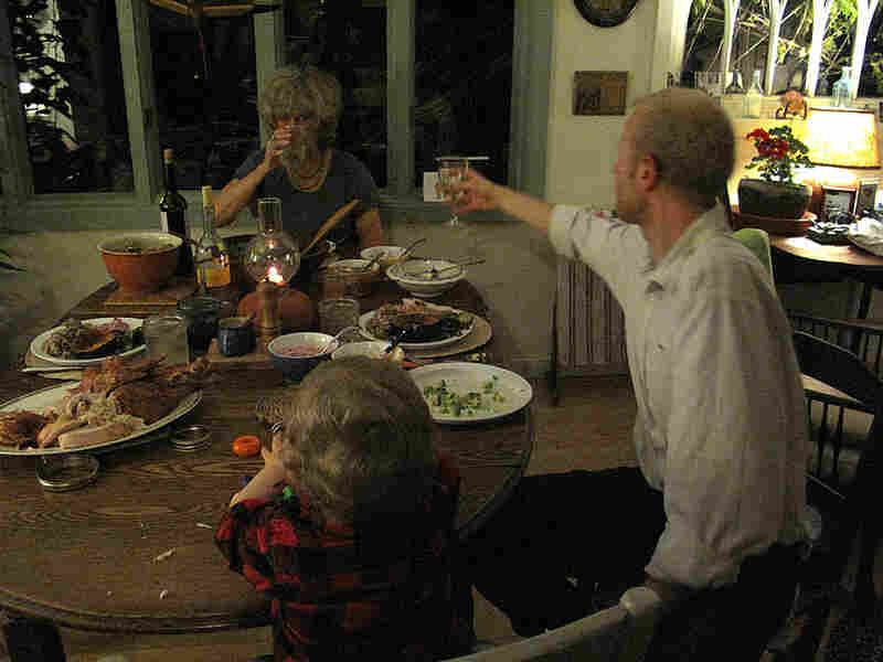 Caitlin's mom, son and husband celebrate the couple's recent good news during Thanksgiving dinner.