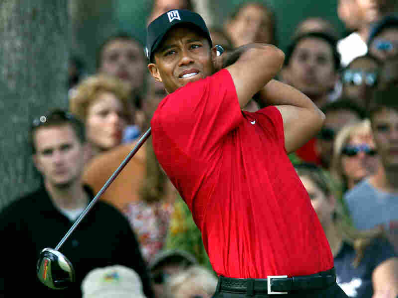 Tiger Woods watches his drive on the 11th hole during the final round of the Buick Open tournament.