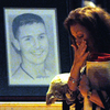 Family and Marines pass the line of portraits. Jeff Janowski for NPR