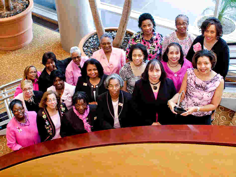 A group of African-American breast cancer survivors pose at an annual survivors'  event.