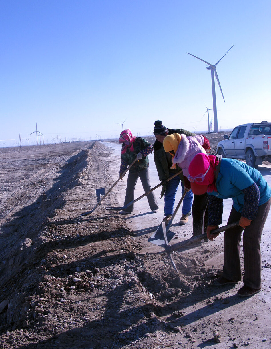 Locals build a road to the Jiuquan wind farm in 23-degree Fahrenheit weather. They say they love the wind farms for the estimated 6,000 jobs a year they bring.