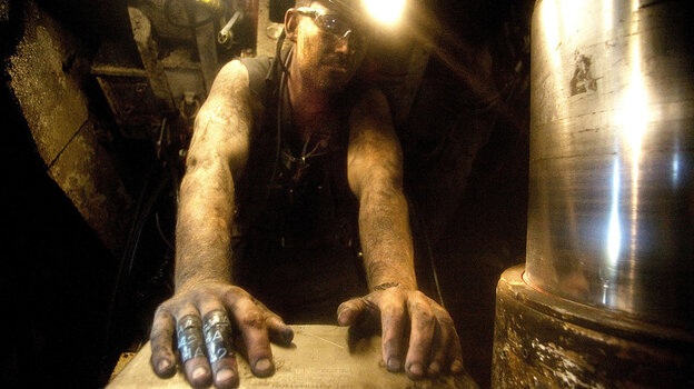 Mike Snyder of Delta, Colo., works as a  long-wall shield puller in a coal mine near Somerset, Colo.