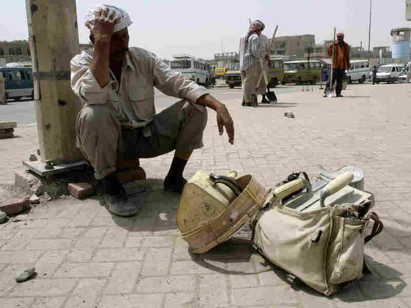 A manual laborer awaits to be employed in Baghdad's Shiite enclave of Sadr City.