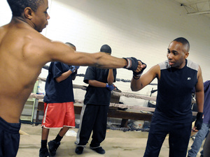 Conservative activist Marvin Rogers (right) prepares to spar against Jason Mobley in Rock Hill.